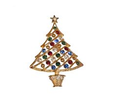 This Eisenberg Ice pin is a beautiful expression of holiday style. Large stylized Christmas Tree in gold metal hung with brilliant rhinestones in clear, blue, red and green. A clear rhinestone star si