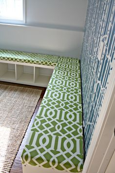 How to turn an IKEA Expedit bookcase into an upholstered storage bench. Might be doing something similar in our family room @ DIY Home Ideas