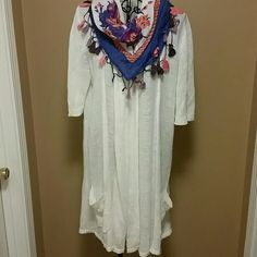 Long cream color cardigan and scarf size large Beautiful cardigan by Calvin Klein.  Size large 55% linen 45% viscose   Matching scarf  Make me an offer or bundle to save even more. The more you buy the more you save. Just ask :) Calvin Klein Sweaters Cardigans