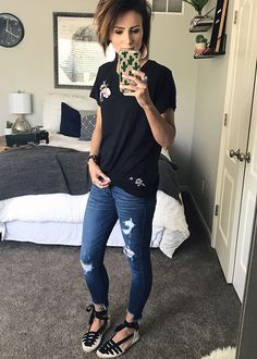 This outfit is sooooo good. Black embroidered t-shirt, distressed denim, leather earrings, and ankle wrap flats.