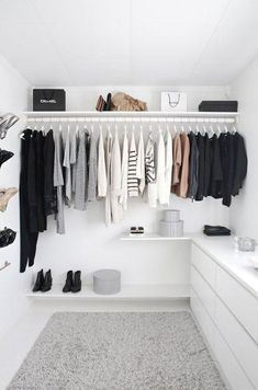 15 Minimalist Hacks To Maximize Your Life -- Start cleaning and organizing now to achieve the minimalist closet of your dreams! Love this all-white walk-in closet with a gray shag rug and dresser with wall shoe rack, perfect for a stylish storage solution