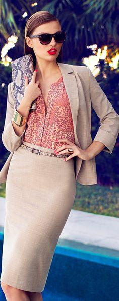 Matching khaki skirt suit w/ animal print top, belt, and purse; metallic jewelry