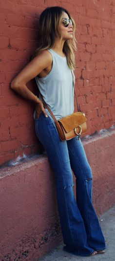 70's inspired flare jeans paired with a simple tank top. Via Julie Sarinana Jeans/Top: Paige Denim, Bag: Chloe. Flare Jeans Outfits