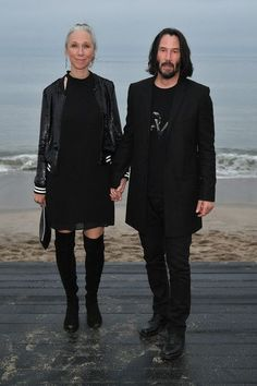 Keanu Reeves Photos - (L-R) Alexandra Grant and Keanu Reeves attend the Saint Laurent Mens Spring Summer 20 Show Photo Call on June 2019 in Malibu, California. - Saint Laurent Mens Spring Summer 20 Show - Photo Call Keanu Reeves John Wick, Keanu Charles Reeves, Keanu Reeves Girlfriend, Alexandra Grant, Arch Motorcycle Company, Alex Winter, Face The Music, Just Jared Jr, Hollywood