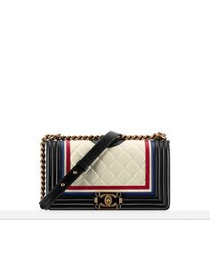 """Cruise 2015/16 - Lambskin """"Boy Chanel"""" flap bag embellished with an enamel clasp and a crest"""