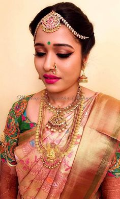 Bridal makeup on fleek! Our bride Amitha looks gorgeous for her muhurtam. Makeup and hairstyle by Vejetha for Swank Studio. Pink lips. Winged eyeliner. Maang tikka. Jhumkis. South Indian bride. Eye makeup. Bridal jewelry. Bridal hair. Silk sari. Bridal Saree Blouse Design. Indian Bridal Makeup. Indian Bride. Gold Jewellery. Statement Blouse. Tamil bride. Telugu bride. Kannada bride. Hindu bride. Malayalee bride. Find us at https://www.facebook.com/SwankStudioBangalore
