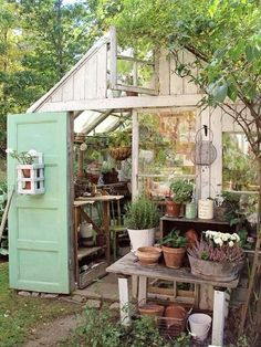 Love this combination greenhouse and potting shed.