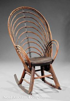 An American Vernacular Twig Rocking Chair, 19th c., Tennessee, bentwood back and arms, circular plank seat, splayed legs joined by stretchers, height 38 1/2 in.
