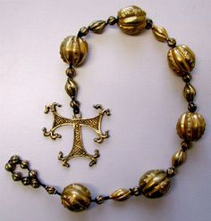 "Rosary with Cross of Tau pendant 1501/1550 The Cross of Tau has been considered a means of protection against the plague since the 6th century. It is also the symbol of St. Anthony, who is called on in cases of ergot poisoning or ""St. Anthony's fire""."