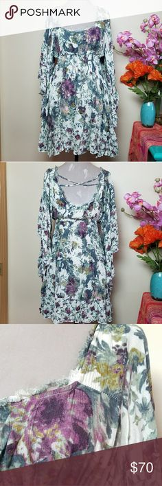 """Free People Heart of Gold Watercolor Floral Dress Watercolor floral printed angel sleeve mini dress. Criss cross back cut out detail with elastic waist and front adjustable tie. Raw hem for an edgy bohemian look! 100% rayon and in the tea colors. Labeled size small petite but was a great transitional maternity dress for me as a size large at 5'7"""".  Would prefer to trade for a larger size in only this colorway so my boobs can also enjoy this dress as post-twin boobs need more room haha! 😂💕…"""