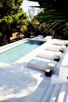 private long plunge outdoor pool with a white deck - DigsDigs