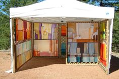 Jennifer Berry Art - Great art booth. Love the depth created with the lattice wall on the right.