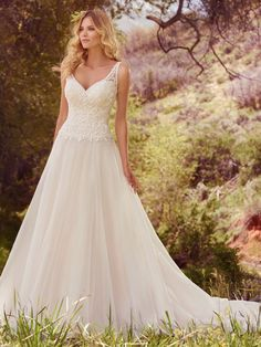For every bride, there is a perfect wedding dress waiting to be discovered. Romantic ball gowns, chic sheath dresses, form-fitting mermaid gowns... it's all here at Maggie Sottero. Come along with us... your fairytale awaits.