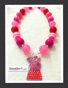 Our Peppa Pig Inspired Pink Bubblegum Bead Necklace with white, pink and red beads and featuring a rhinestone peppa pig pendant is just $18 including shipping (untracked) anywhere in Australia. More designs available at www.bubblegumroyal.com