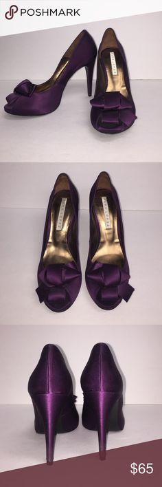Gorgeous Pura Lopez high heels! Size 9! Pura Lopez designer purple satin and leather heels with bow!!! Size 9 or Euro 39. Made in Spain. Slight black mark on right left heel but barely noticeable!  See pics. Only worn once. Very good condition. No toe imprints inside whatsoever! Beautiful shoes!!! 😍😍😍 Pura Lopez Shoes Heels