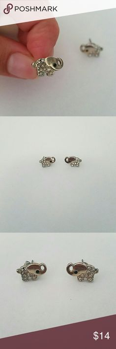 Francesca's Silver Elephant Earrings Earings are silver. The pink tone is the reflection of my phone case Tags: francescas silver elephant earrings animal jewelry womens juniors Francesca's Collections Jewelry Earrings