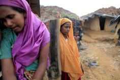 Rohingya of Myanmar face statelessness :: Rohingya women stand in front of their makeshift home in an unregistered Rohingya refugee camp in Teknaf, Bangladesh, June 17, 2012. (Reuters/Andrew Biraj, courtesy the Thomson Reuters Foundation – AlertNet)