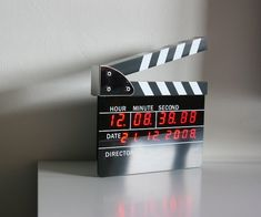 It's made of soft plastic and some metal, and looks like a clapper but tells time like any other clock.