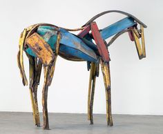 Ms. Butterfield uses metal to create life-size horses