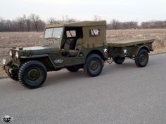 US Army 1951 Willys MC M38 Jeep (with canvas top cover on and supply trailer attached to the tow hitch)
