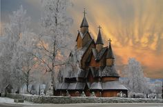 Frost & Fire - This is the largest Stave Church in Norway, and about 800 years old. This day was very cold and frozen .. but the sky was in fire .. I will share it with you. Wish you all a wonderful weekend :o))