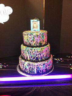 Glow in the dark splatter paint cake for a black light party