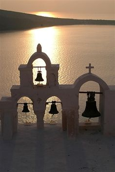 Nice sunset...Ola church bells, Santorini, Greece