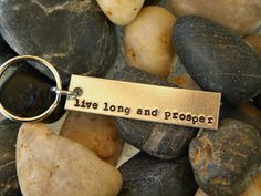 """A fun gift for any Star Trek fan! This keychain is stamped with """"live long and prosper"""", one of the most famous Star Trek quotes. Measures x I use only high quality pure aluminum It wil Hello Computer, Star Trek Quotes, Famous Stars, Nerd Geek, Live Long, Wood Signs, Best Gifts, Geek Stuff, Pure Products"""