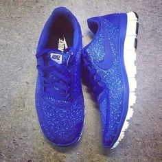 Royal blue nike tennis shoes with a touch of sparkle! (: lovee them