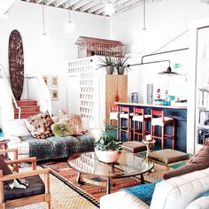 white industrial vibe, jute rug with tribal rug overlay, industrial lamps, & a hint of midcentury