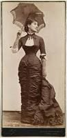 This is my wife Annie, in a beautiful dress. Her waist is so thin because she is wearing a corset, but I don't think, she likes wearing it because it is uncomfortable...