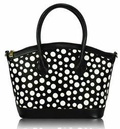 Moderní okouzlující černobílá kabelka na zip, prostorná. Uvnitř v podšívce kapsa na zip a dvě malékapsičky na drobnostibez zipu. Nastavitelný popruh
