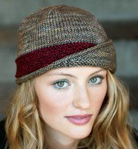 Cute hat, I would add a big button.  Knitting Daily