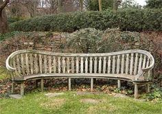old curved wooden bench