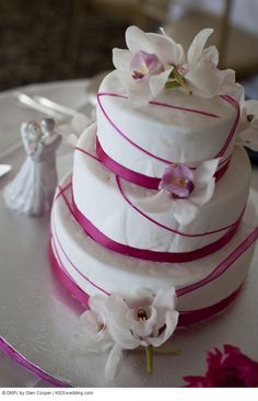3 tier cake with orchirds from Jillian & Michaels White and Pink Beach Wedding