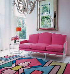 Abstract Rug Room: So many elements make this room amazing. I really want a pink sofa someday.