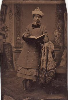 Well dressed young African-American woman holding a book. Bought in an antique store in Muskogee, Oklahoma.
