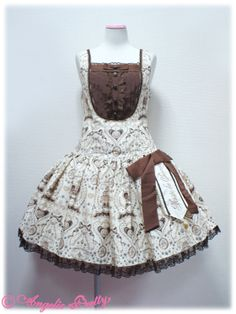 132J8-2816 Musee du Chocolatローウエストジャンパースカート Brand:  Angelic Pretty Item Type:  JSK Price:  ¥24,990 Year:  2013 Colors:  Brown, Ivory, Mint, Pink Features:  Lining, Partial shirring, Dropped waist, Detachable bow, Removable waist ribbon, Side zip Bust:  ~92-110cm Waist:  ~72-92cm Length:  ~84cm
