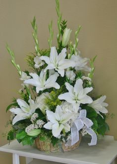 An all white flower arrangement including white lilies made by your local riverside florist - Willow Branch Florist of Riverside http://www.floristofriverside.com/