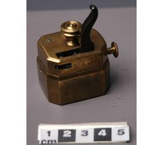 """SCARIFICATOR : Manufactured between 1800-1899. Spring-loaded device that releases blades in order to cut the patient. This facilitated the practice and """"treatment"""" of bloodletting. (Source: Picture link). A scarificator in action is demonstrated here, presented by the Museum of Science and Technology : https://www.youtube.com/watch?v=TZNVEfGjjNQ."""