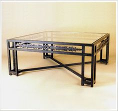 """10014  IRON TABLE SHOWN WITH OPTIONAL BEVELED GLASS FINISH SHOWN: PUEBLO BASE DIMENSIONS SHOWN W 42"""" L 42"""" HT 18"""""""