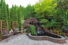 Backyard Garden landscaping with waterfall pond trees plants trellis decor patio furniture brick pavers Backyard Garden Landscape, Backyard Farming, Garden Landscaping, Landscaping Ideas, Landscape Design, Garden Design, Asian Garden, Raised Planter, Unusual Plants