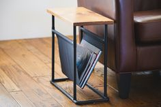 There's a fine line between having stacks of ample reading material on the coffee table and piles of clutter. If you're in need of additional storage, this side table does double duty as a...