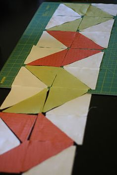 Knitty Bitties: Zig-Zag Table Runner {Tutorial} (uses Accuquilt product to cut triangles)