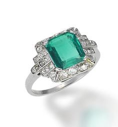 An emerald and diamond ring, circa 1930  The cut-cornered step-cut emerald, within a tiered surround of old brilliant-cut diamonds, emerald approximately 1.90 carats, diamonds approximately 0.65 carat total