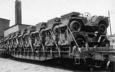 Sixteen jeeps loaded crosswise on railroad flatcars for cross-country shipment, Hampton Roads Port of Embarkation, Newport News, VA, 10 July 1944