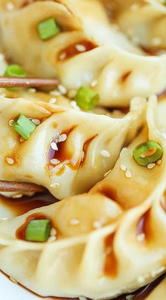 60 calories per potsticker Pork Ginger Potstickers - Super easy, freezer-friendly potstickers made completely from scratch. So hearty AND healthier than take-out! Pork Recipes, Asian Recipes, Chicken Recipes, Cooking Recipes, Indonesian Recipes, Orange Recipes, Kitchen Recipes, Cooking Tips, Easy Recipes