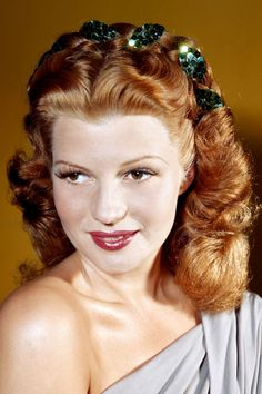 Hayworth's dark red hue was her signature, but a controversial one at that. A Spanish beauty, she was born Margarita Carmen Cansino and had black hair before the studio dyed her hair the rich, flaming hue that helped her skyrocket to fame.