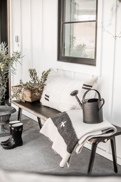 We love mixing old pieces with new and here on our front porch brought together some of our favorite finds to give a modern rustic feel to the space! | Home Decorating | Styled and Photographed by Public 311 Design | #blackandwhitemodernfarmhouse #modernfarmhouse #modernfarmhouseoutdoordecor #frontporchdecor #blackandwhitefrontporch