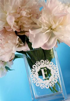 vinyl monogram vase - by Skip To My Lou    Great idea!  We have vinyl monogram stickers on sale at 75% off that would work well for this project!